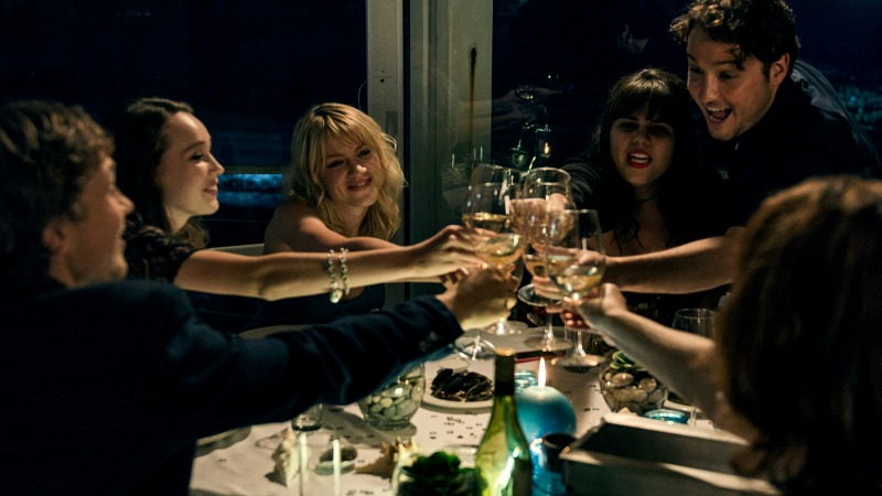 Scene 25; INT Restaurant; Laura (Alycia Debnam - Carey) is sitting with her friends celebrating her birthday.